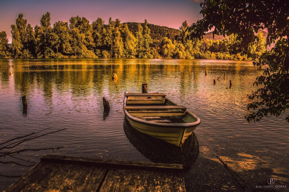 A small old boat on the shore of the Verd pond near the town of Vrhnika, Slovenia