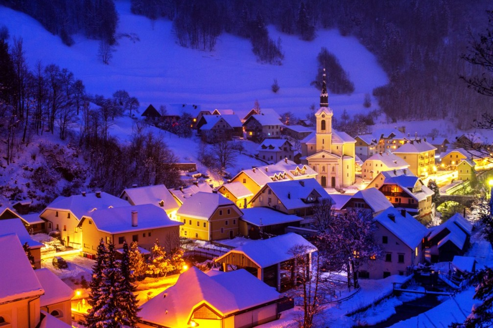 The tiny town of Zelezniki, Slovenia in winter with plenty of snow