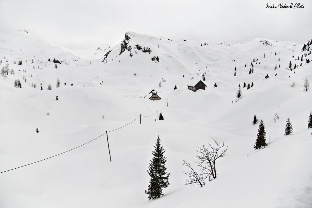 Koca Pod Bogatinim mountain hut on the Komna plateau in the Julian Alps in winter