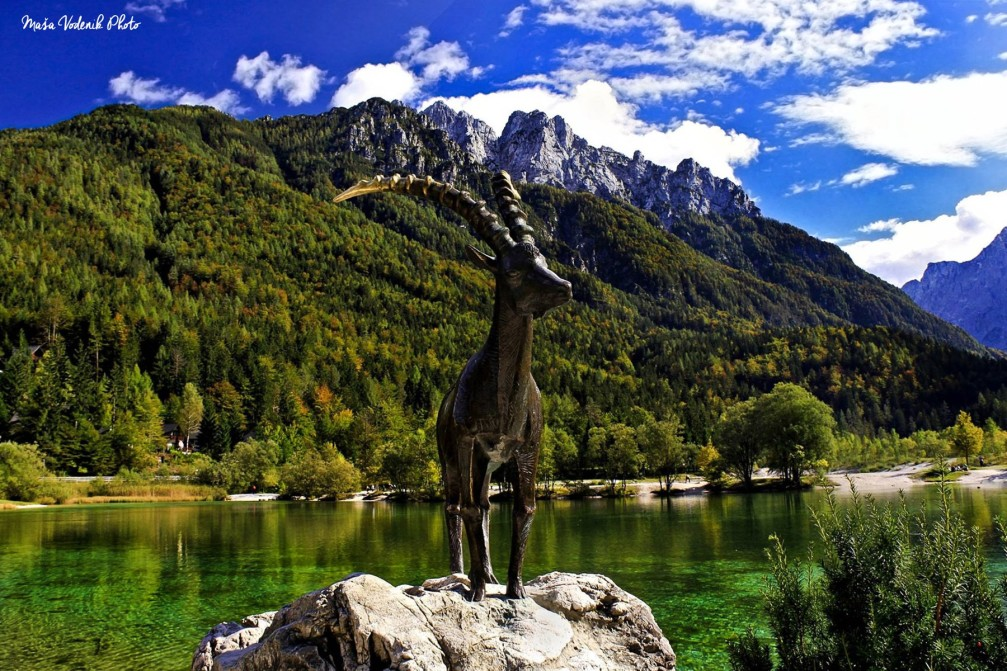 The statue of Goldhorn standing proudly at the shore of Lake Jasna near Kranjska Gora, Slovenia