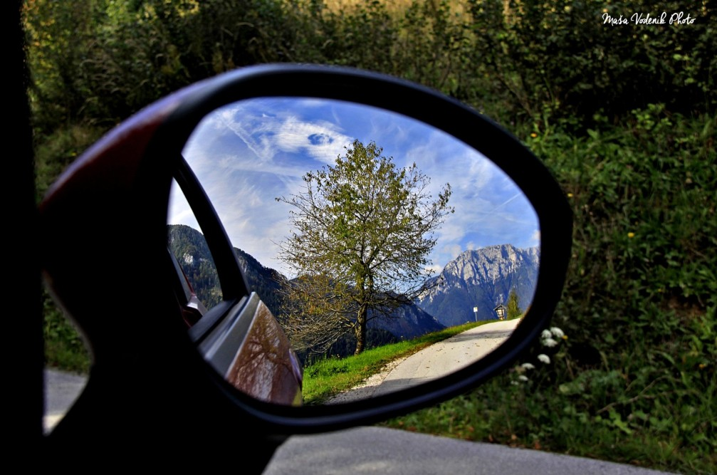 Logar Valley seen in the wing mirror of a car