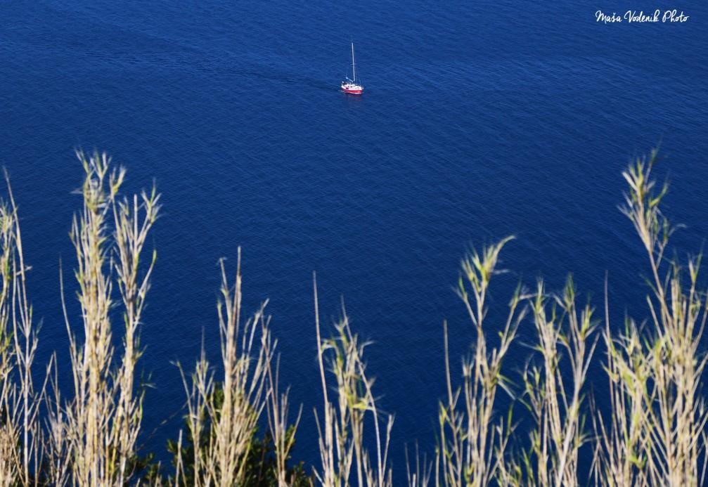 A small sailing boat on the Adriatic Sea, near the coastal town of Piran, Slovenia