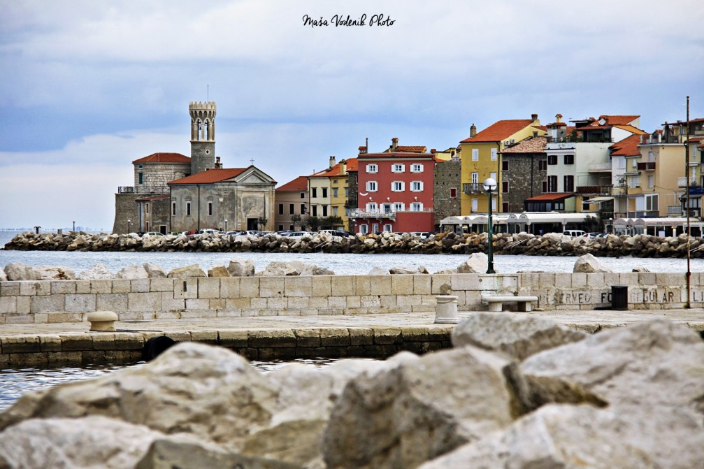 Piran lighthouse and houses at the waterfront, Slovenia