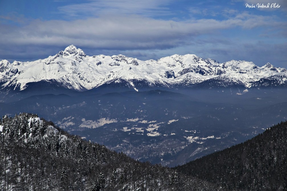 View of Mt. Triglav and the surrounding peaks from the Ratitovec mountain in the Julian Alps