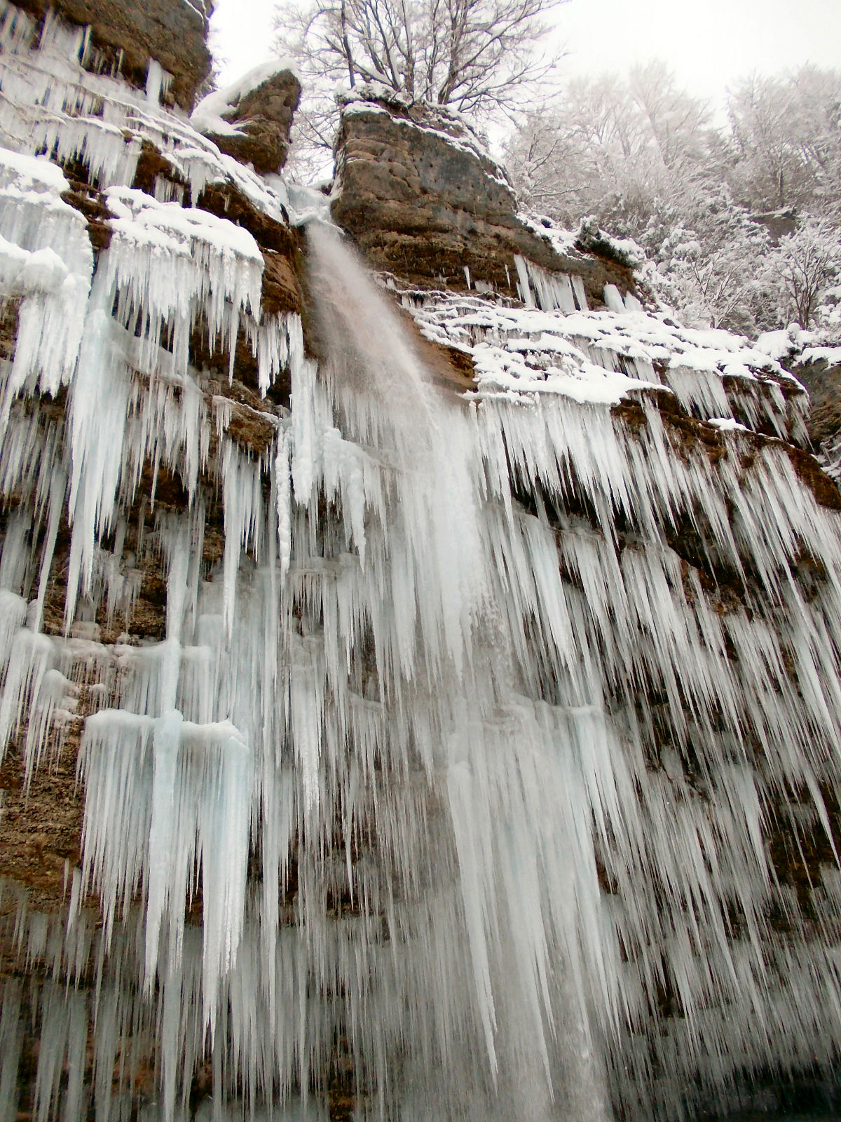 View of the frozen Pericnik waterfall in winter