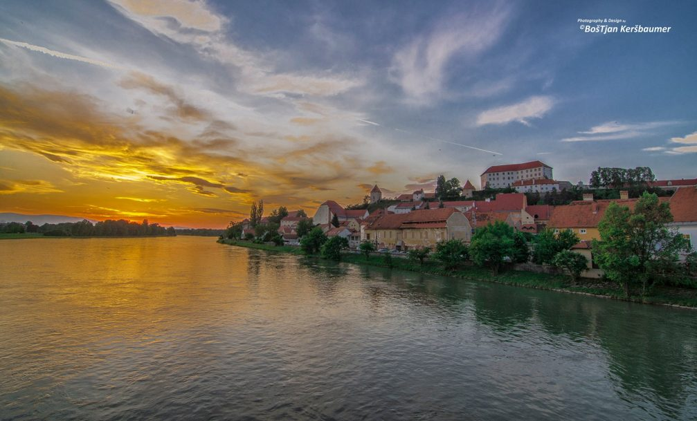 The town of Ptuj, Slovenia and River Drava at sunset