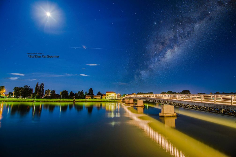 Milky Way over the footbridge in Ptuj, Slovenia at night