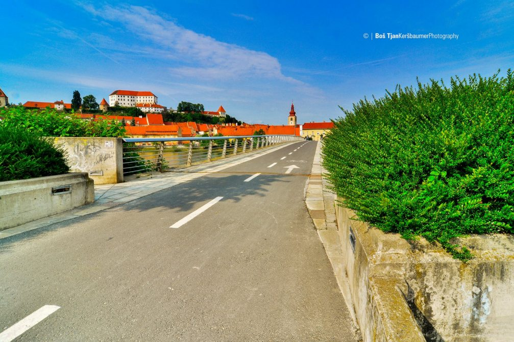 A view of the town of Ptuj from a footbridge over the Drava river