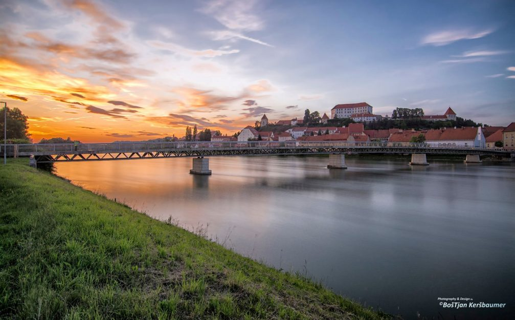 A view of the town of Ptuj with a bridge over the Drava river