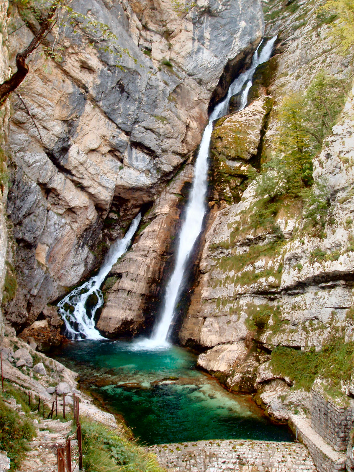 Waterfall Savica with an emerald green pool at its bottom