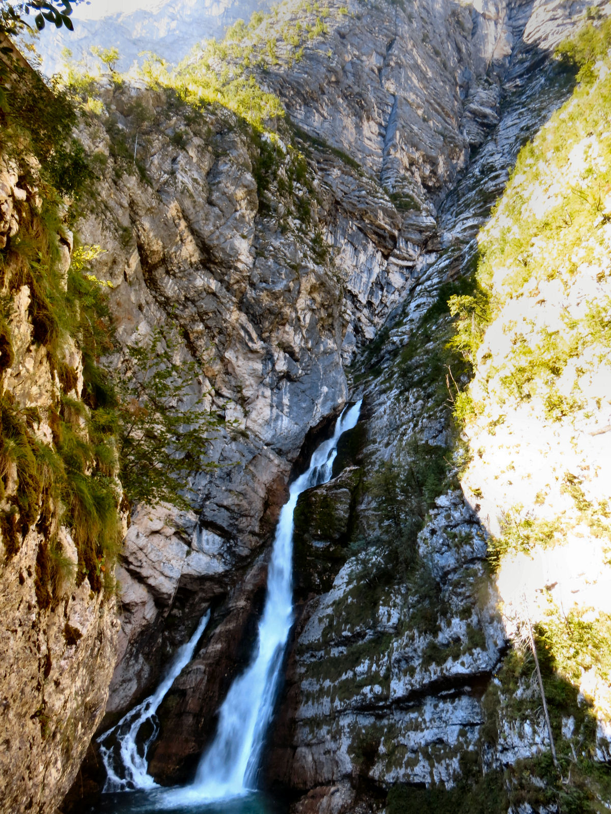 Waterfall Savica situated right under the majestic cliff of Komarca