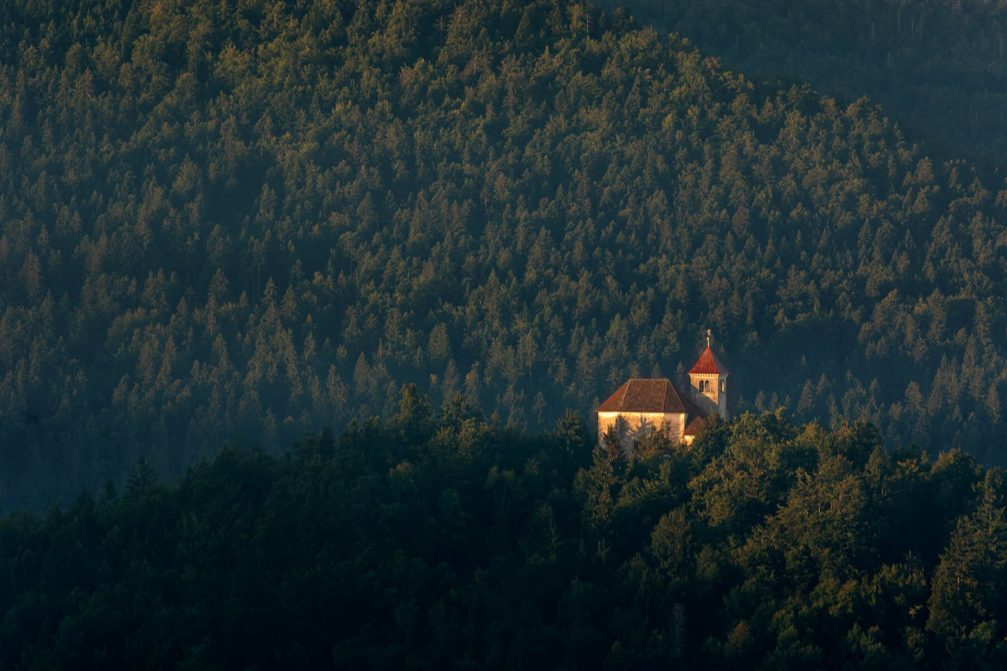 The Church of St Joseph surrounded by woods on the Malecnik hill above Preserje in central Slovenia