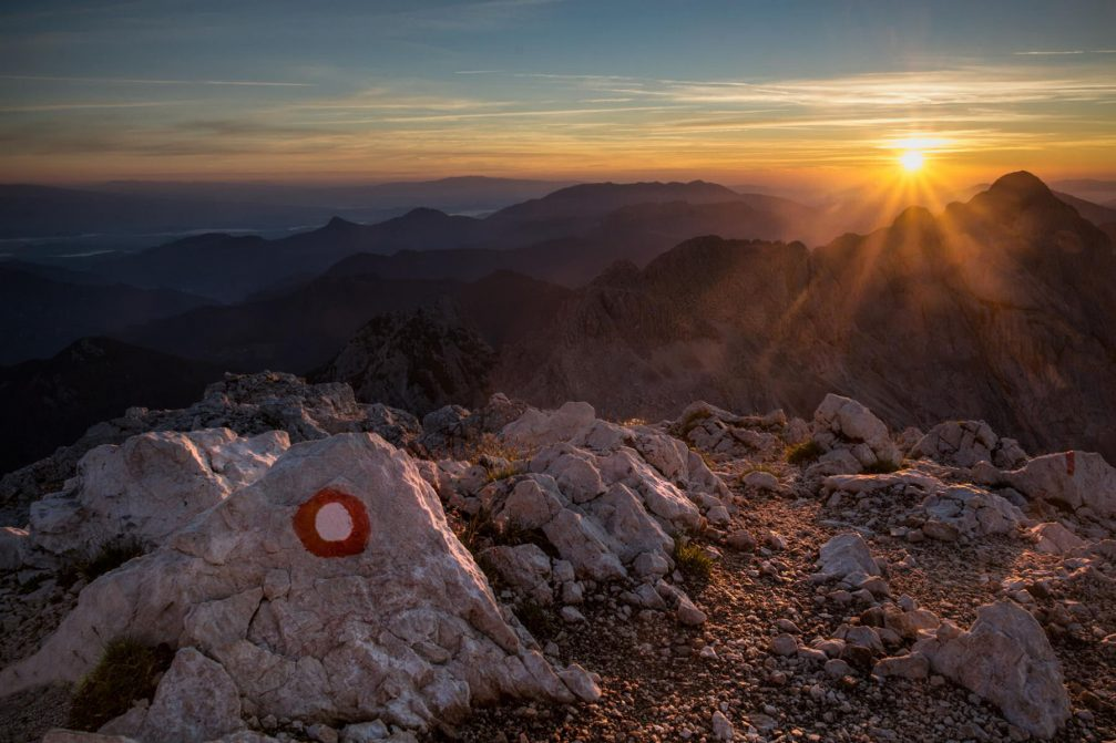 A beautiful sunrise from Grintovec, the highest mountain of the Kamnik–Savinja Alps in Slovenia