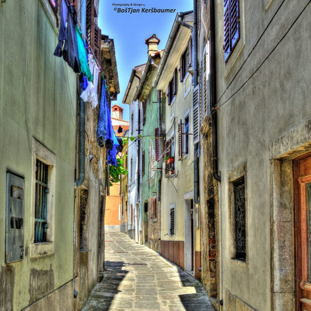 A narrow winding street in the romantic old fishing town of Izola, Slovenia