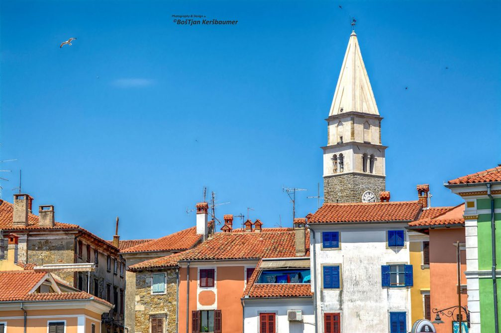 Well-preserved old buildings with red tile roofs in Izola, Slovenia