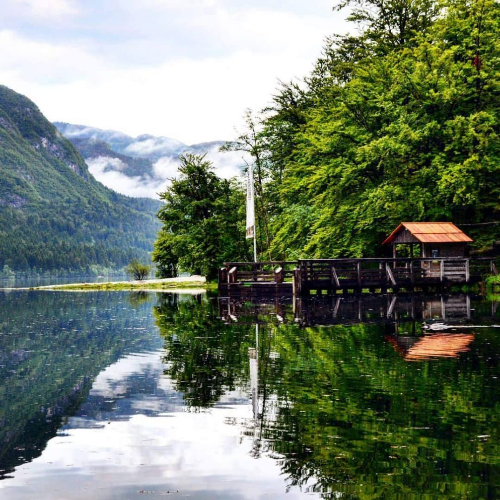 A beautiful view of Lake Bohinj with the reflection of the mountain on its surface
