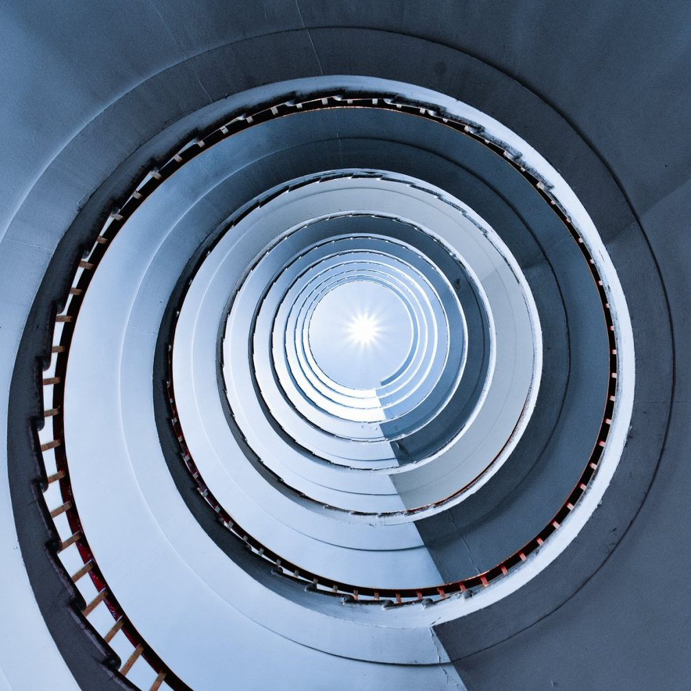 A view up the Art-Deco-style spiral staircase inside the Neboticnik skyscraper in Ljubljana, Slovenia