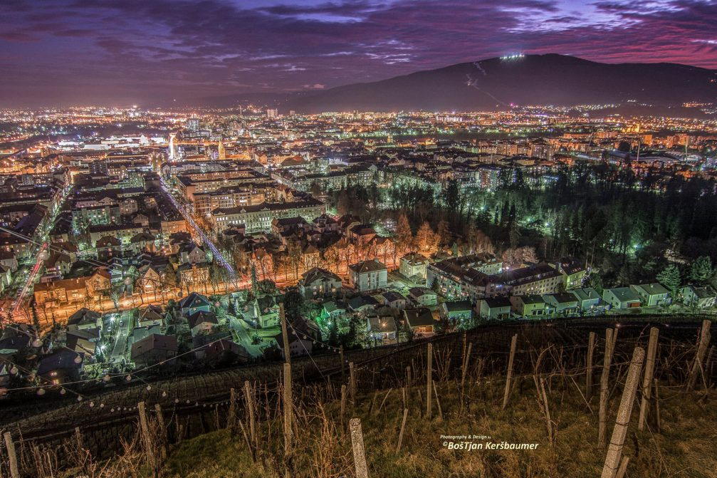 Beautiful elevated night view of the city of Maribor, Slovenia from the Piramida hill