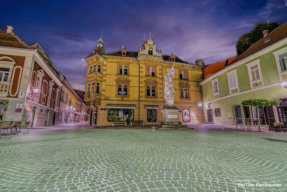 The beautiful Mestni Trg Square in the town of Ptuj, Slovenia, surrounded by interesting architectural buildings
