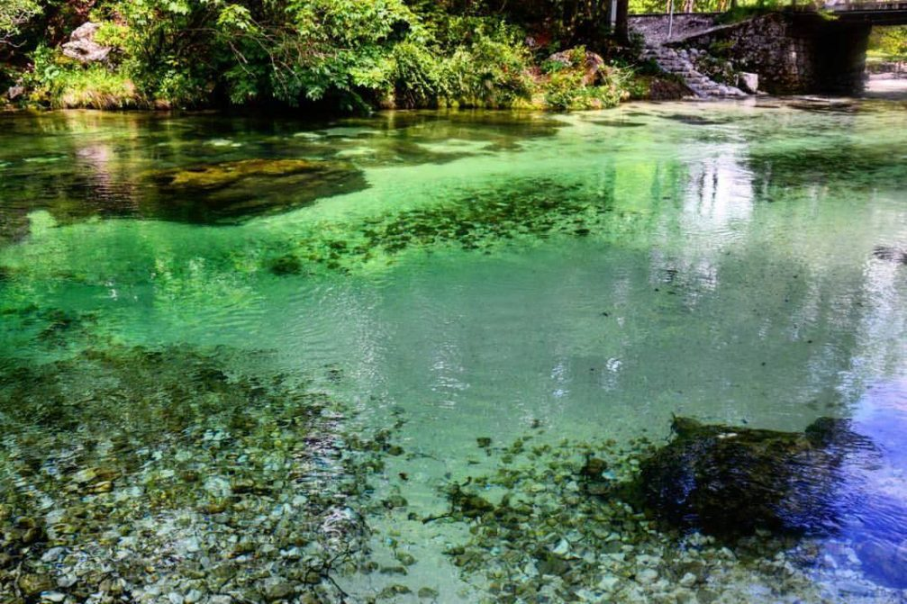 The crystal-clear turquoise water of the Savica stream in Ukanc near Lake Bohinj