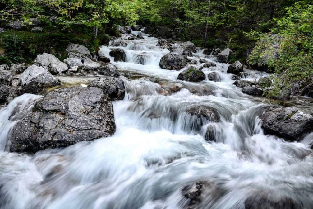 A crystal clear fresh mountain stream in the Trenta valley in the Triglav National Park