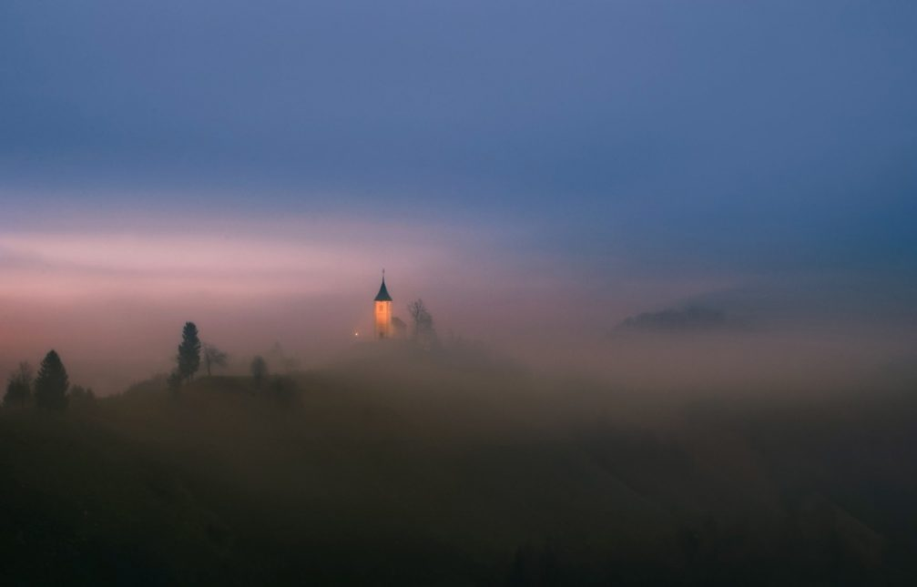 The illuminated beacon of the Jamnik church of Saints Primus and Felician in Slovenia