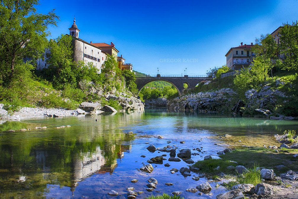 River Soca flowing under the bridge at the town of Kanal Ob Soci, Slovenia