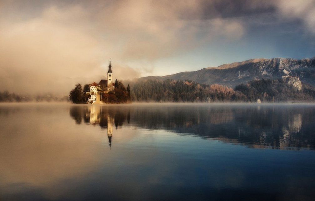 The famous island and church in the middle of Lake Bled in Slovenia in late autumn
