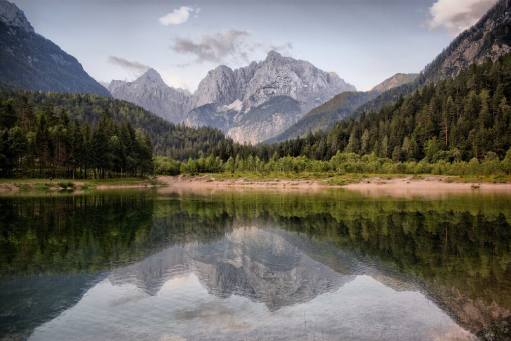 Lake Jasna with spectacular reflections of the surrounding mountains on a crystal clear surface