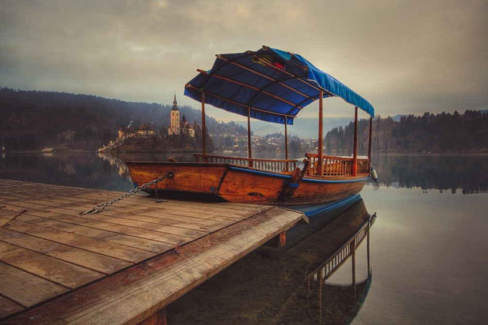 A traditional Slovenian Pletna boat on the shore of Lake Bled in Slovenia