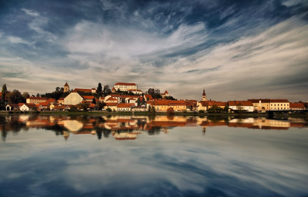 The town of Ptuj stretching out across the Drava River in eastern Slovenia