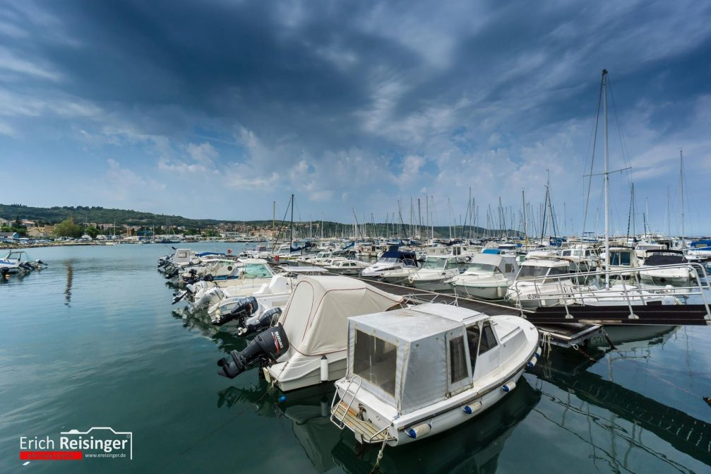 View of the old fishing harbour supplemented with a modern marina in Izola, Slovenia