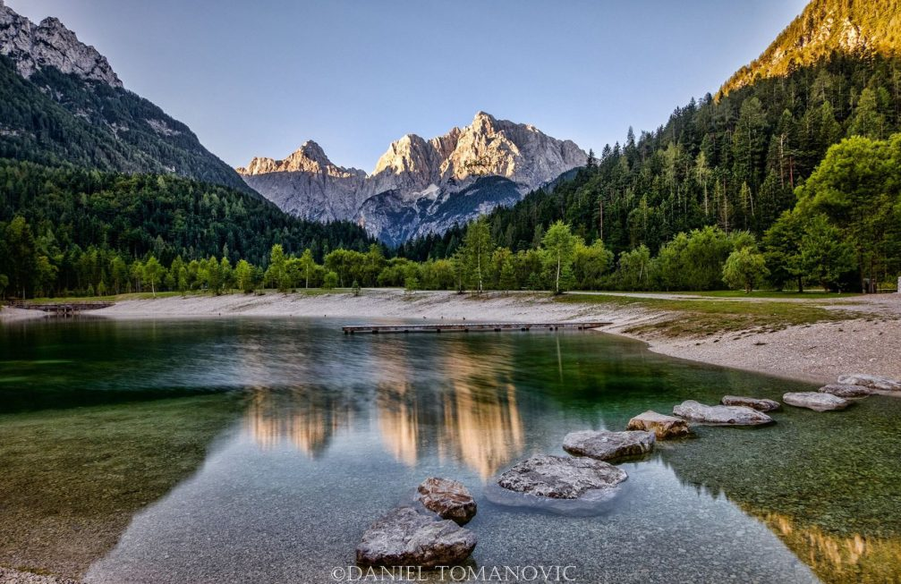 Lake Jasna with stunning reflections of the Slovenian Alps in its calm waters