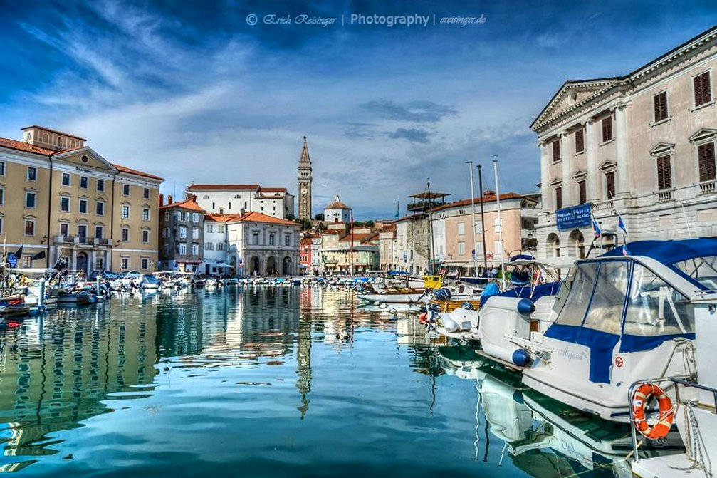 A beautiful view from the small harbour in Piran towards the Tartini square in the background