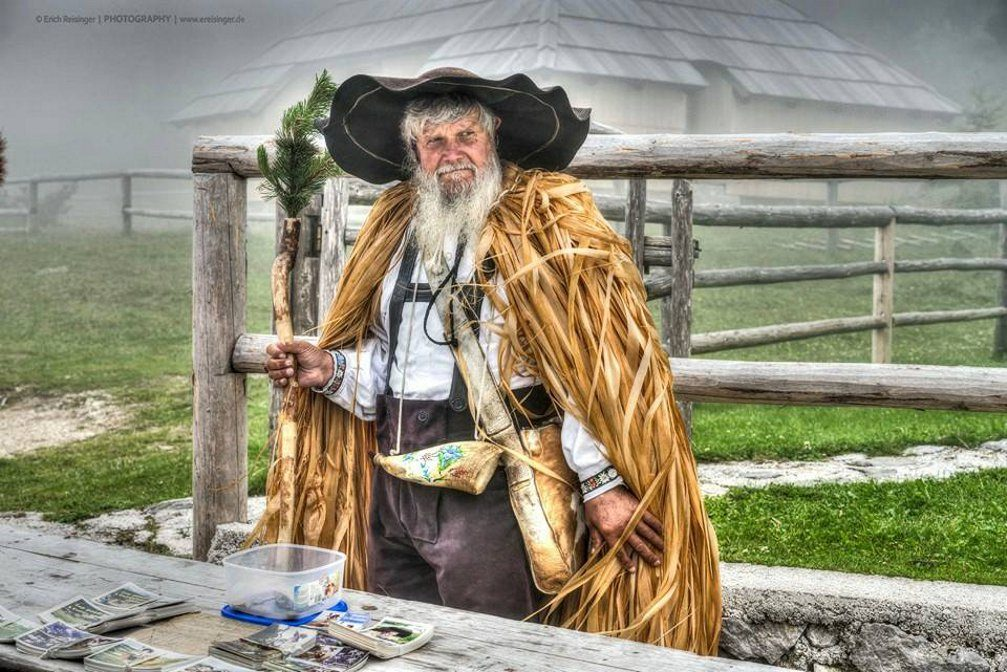 An older man wearing a traditional herdsman's costume on the Velika Planina plateau in Slovenia