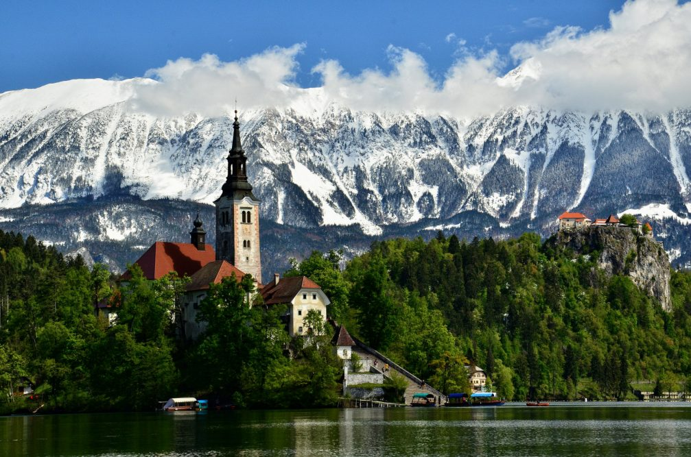 The medieval Bled Castle and the Church on the island in the middle of Lake Bled, Slovenia