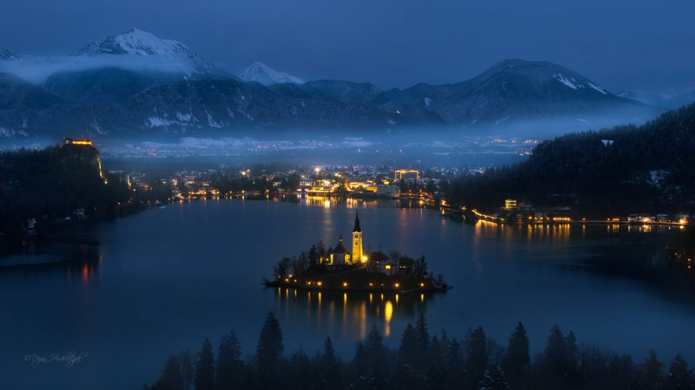 Panoramic view of the town of Bled, Slovenia at winter night from the Ojstrica viewpoint
