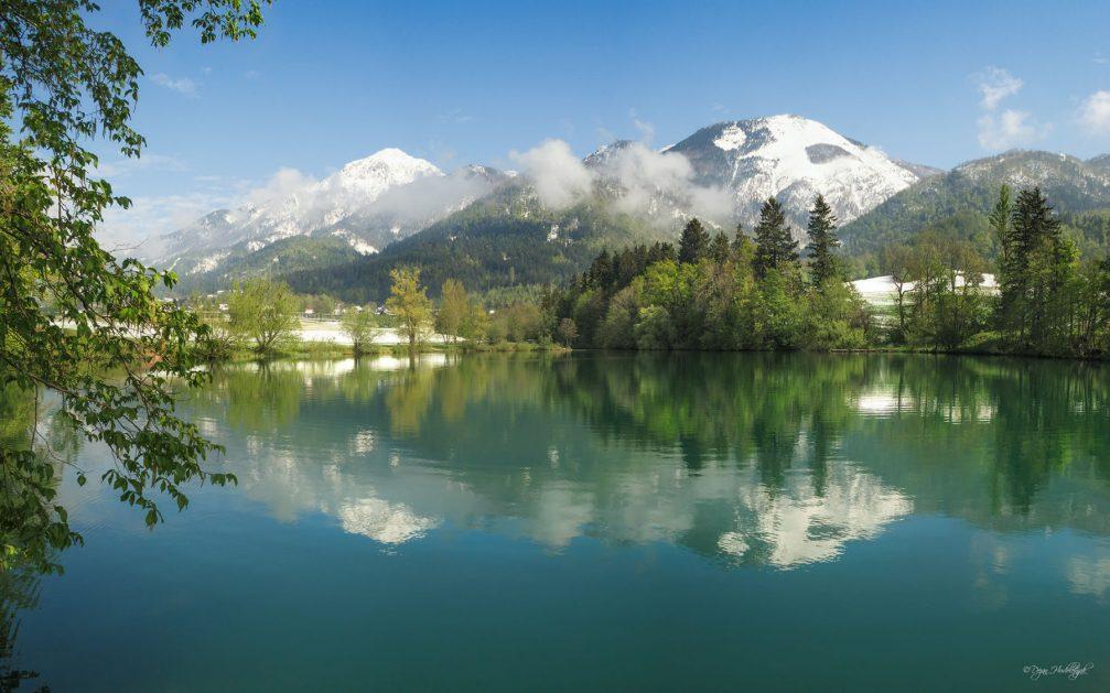 The dark green surface of the beautiful Lake Crnava in Preddvor in northwestern Slovenia