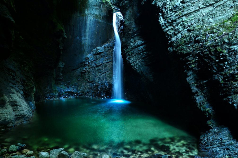 The 15-metre-high Kozjak Waterfall with an emerald green pool at is base