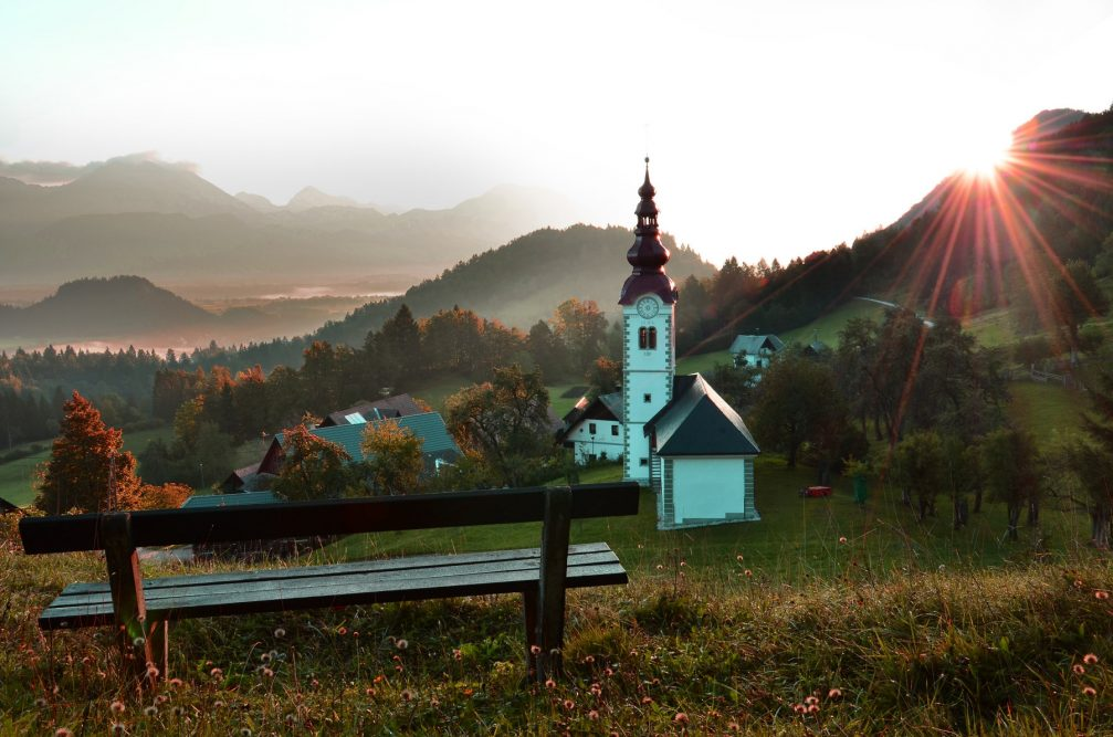 Succursal Church of St. Steven in the village of Kupljenik in northwestern Slovenia at sunrise