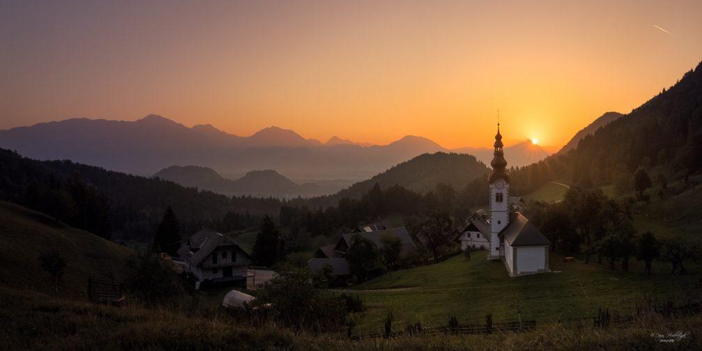 Village of Kupljenik with its Succursal Church of St. Steven at sunrise