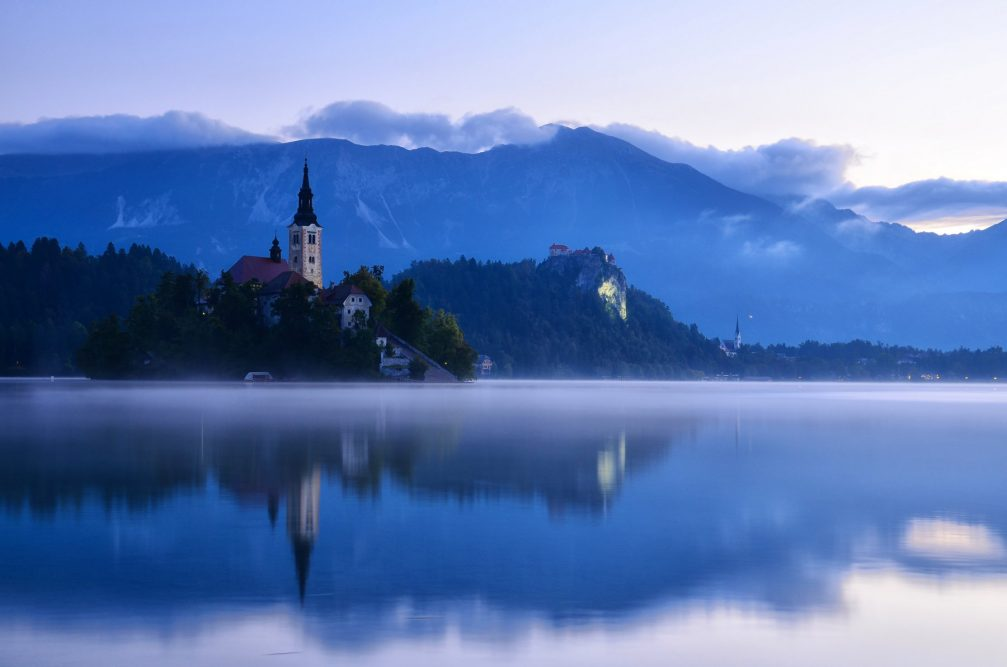 View of the Island and the Castle from the surface of Lake Bled in Slovenia