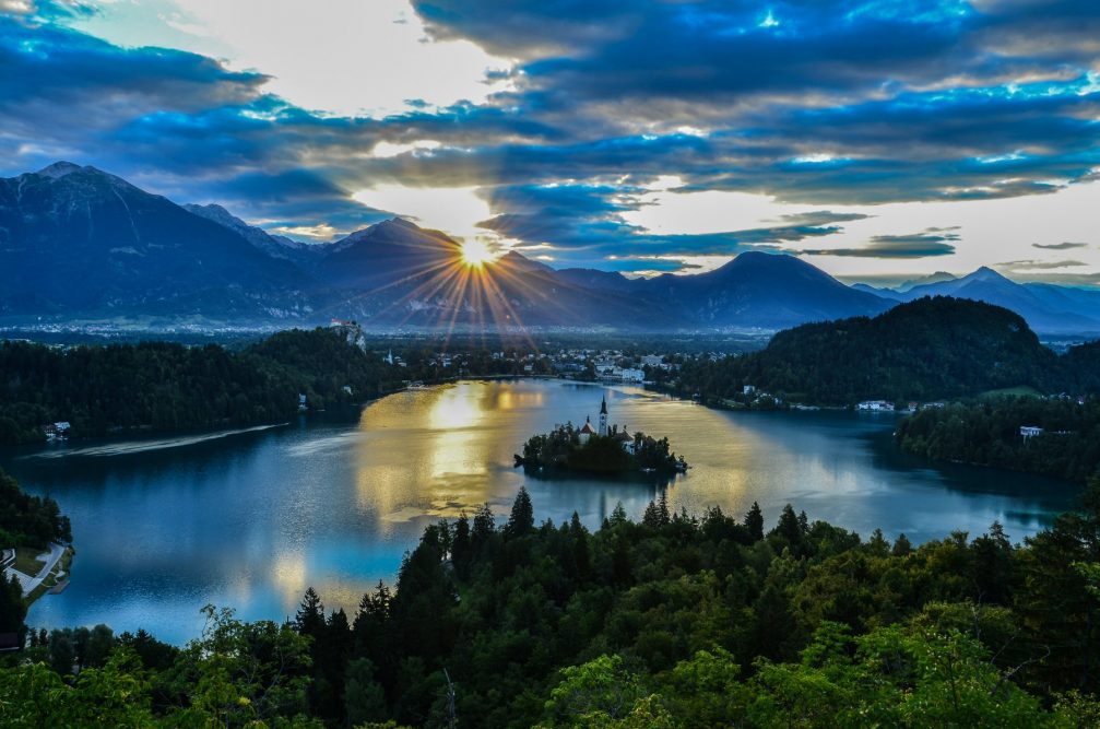An elevated view of Lake Bled from the Ojstrica viewpoint at sunrise