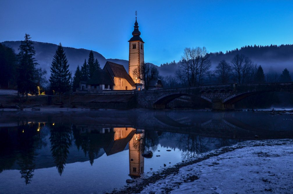 The Church of St. John the Baptist at Lake Bohinj, Slovenia illuminated at night