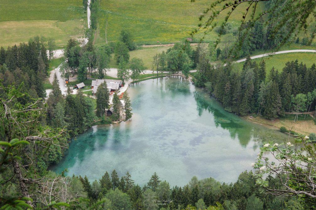 An aerial view of the heart-shaped Plansarsko Jezero Lake in Jezersko in Slovenia