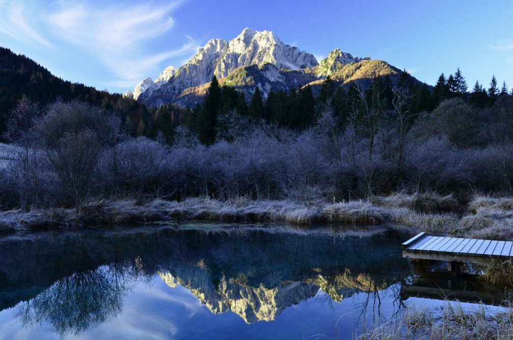 Lake Zelenci in the winter season with the Julian Alps in the background