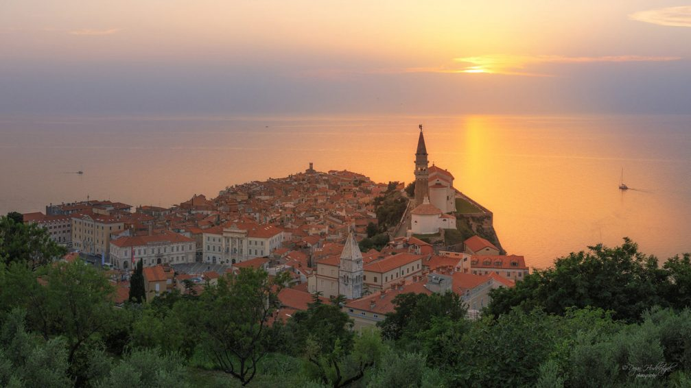 An elevated view of the coastal town of Piran, Slovenia from the town walls at sunset