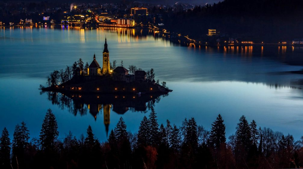 Elevated view of Lake Bled and its island by night