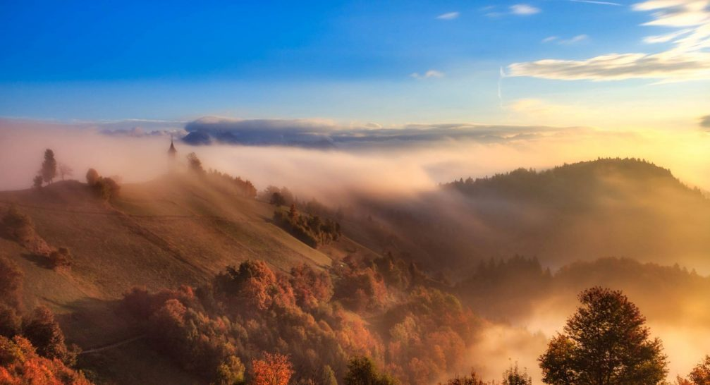 The hilltop Church of Saints Primus and Felician in Jamnik, Slovenia taken on a misty morning
