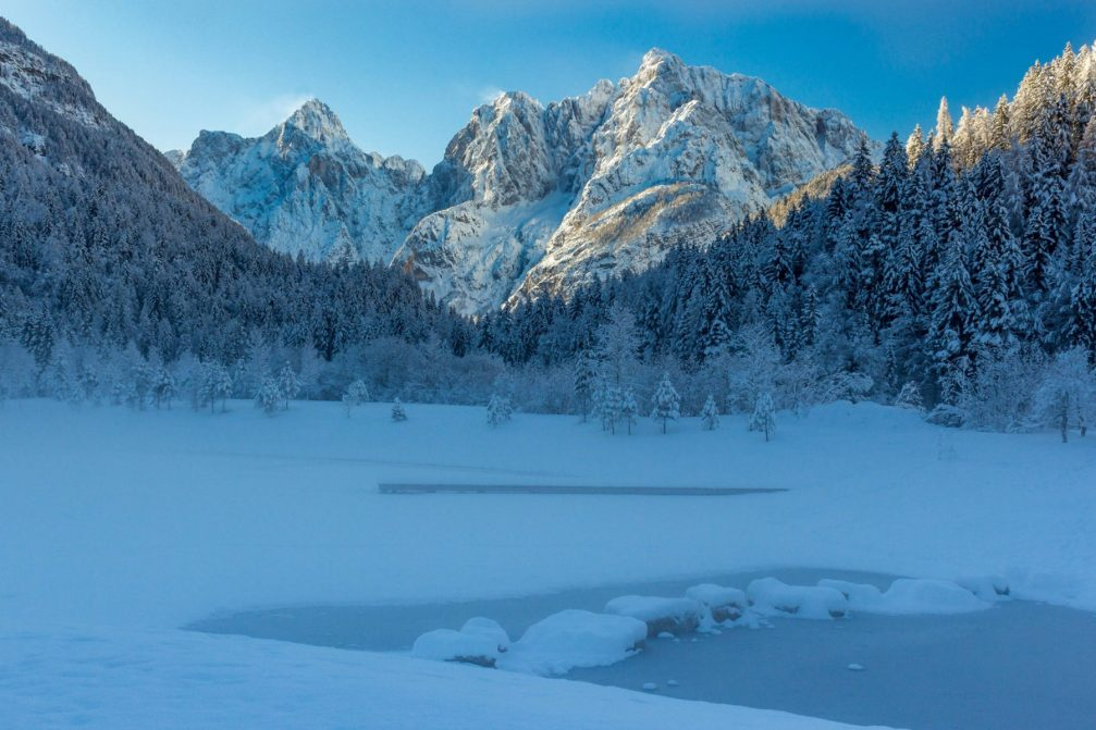 The frozen Jasna Lake in winter with lots of snow, Kranjska Gora, Slovenia